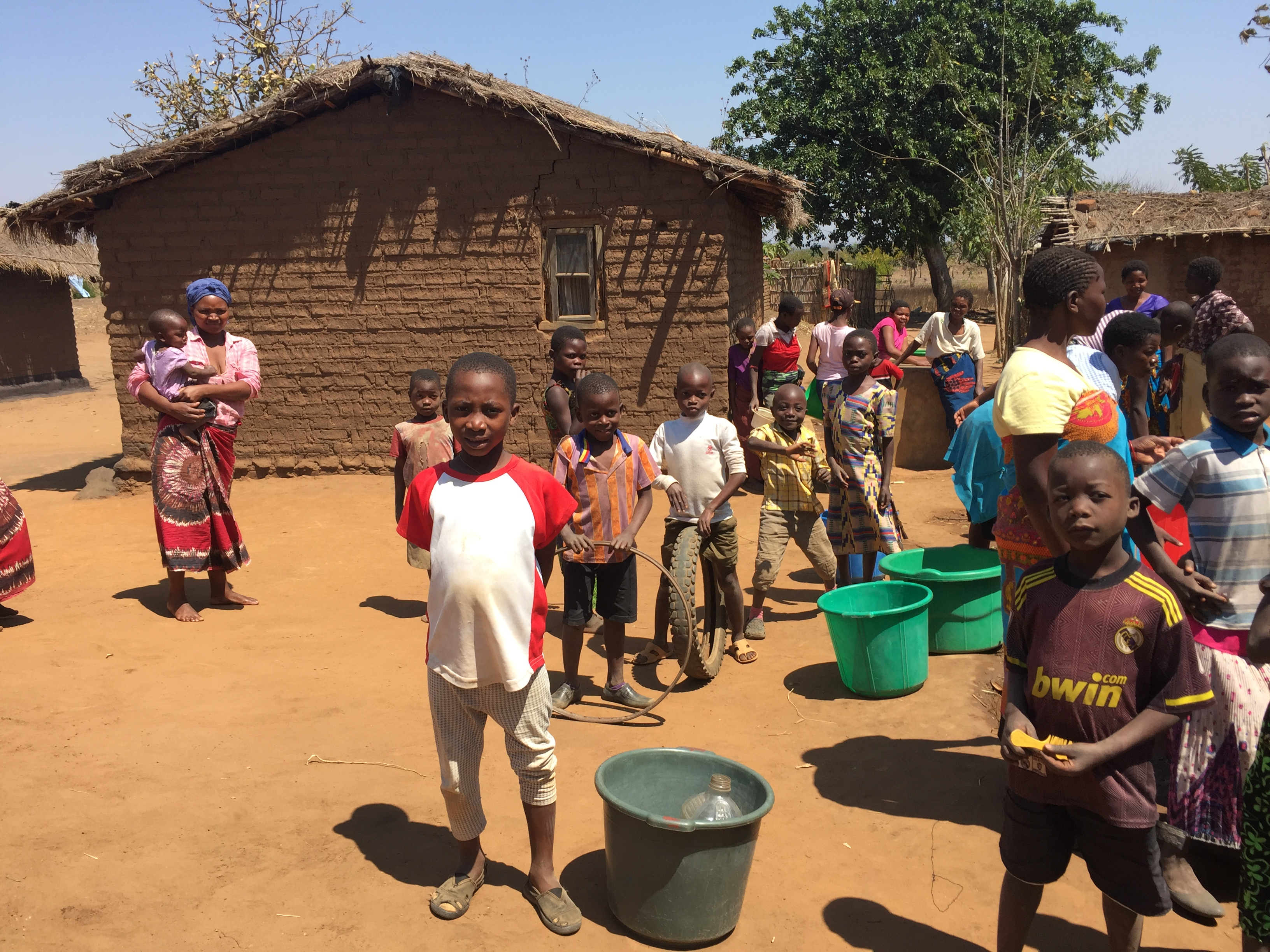 Africa Boy Water Bucket